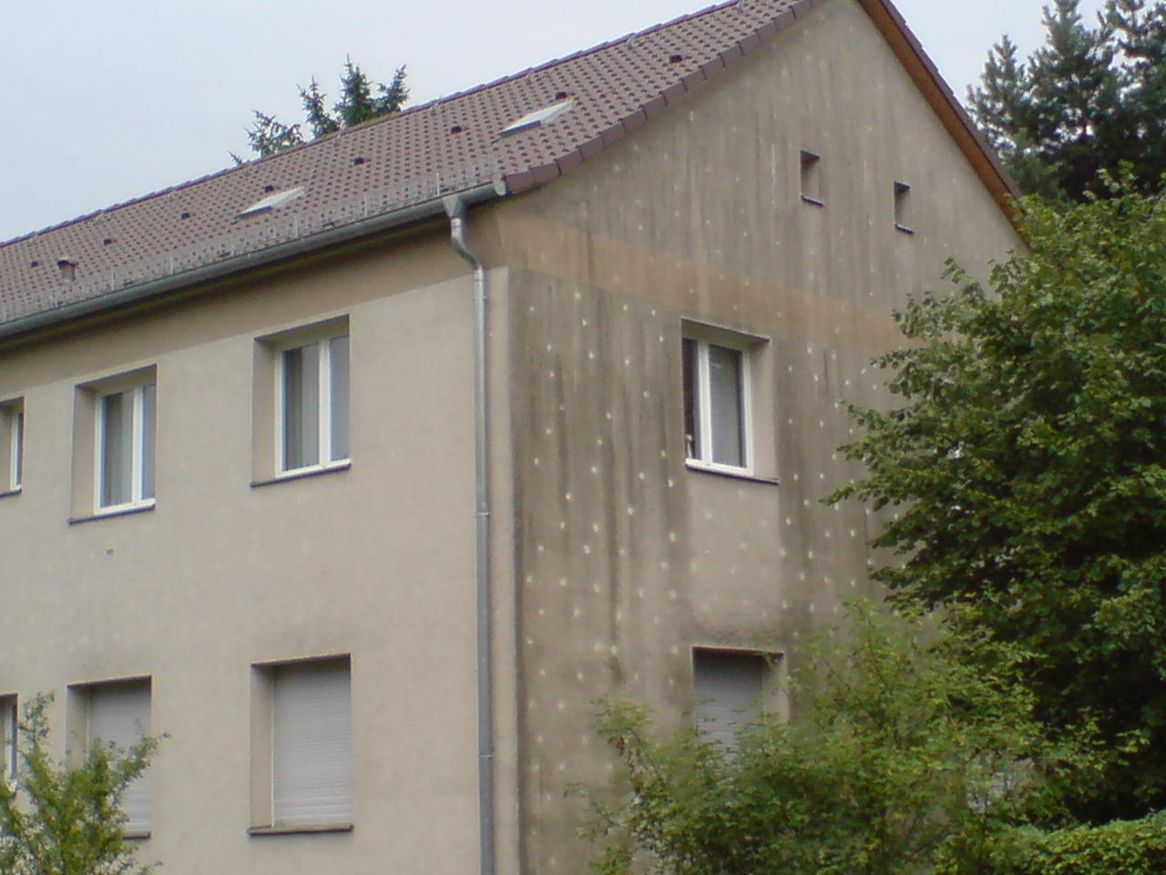 Bestandsgebäude mit gedämmter Fassade